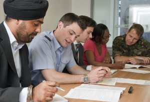 Civil servants meet with military personnel. [Photo by Harland Quarrington; Crown Copyright]