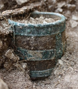 A wooden and copper drinking vessel found during excavations on Operation Nightingale (Crown Copyright)