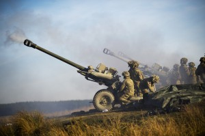 Image of The Royal Artillery firing 105mm Light Guns on exercise. (Photograph by Richard Watt; Crown Copyright)