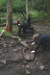 An image of an ex-Paratrooper and a University of Leicester archaeology student excavating the site of the Georgian house. (Helen Pickering; Crown Copyright)