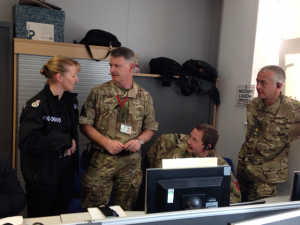 Military liaison officers Lt Col Graham Whitmore (second from left), Maj Sean Norman & Maj Duncan Mortimer discuss events with Acting Chief Constable Dee Collins, from North Yorkshire Police, at Tour de France Gold Command, Wakefield Police HQ.