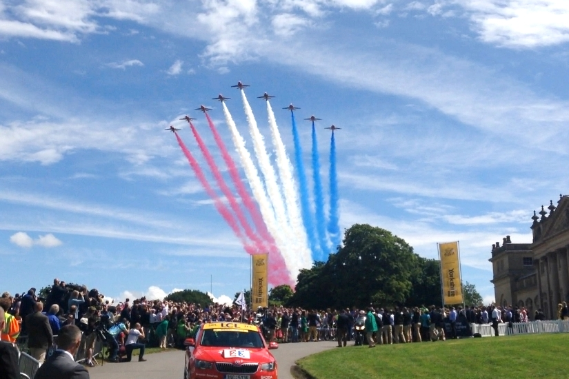 The Red Arrows fly over Harewood House at the start of the race. (Crown Copyright)