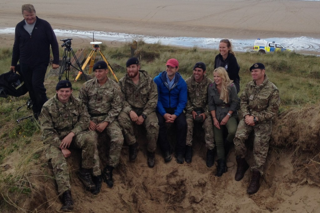 Royal Navy Southern Diving Group and DIO EOC staff pose with Countryfile presenters Ellie Harrison and Matt Baker on Whitsand Beach, the Gower, Wales. (Crown Copyright)