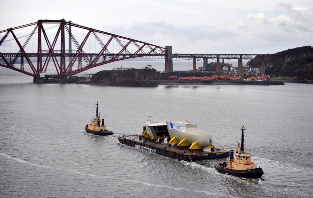 Part of the bow of HMS Queen Elizabeth being transported on the River Forth.