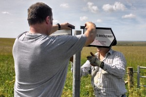 Volunteers erecting signs showing a permissive bridleway. (Crown Copyright)