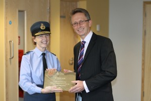 AVM West and Graham Jeffery with a commemorative plaque marking the completion of SLA at DMS Whittington. [Crown Copyright]