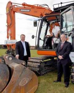 Project Director from Carillion, Trevor Pratt; Commanding Officer of RNAS Yeovilton, Commodore Jock Alexander, and DIO Deputy Head Manager Projects West, Matt Harris with a mechanical digger.