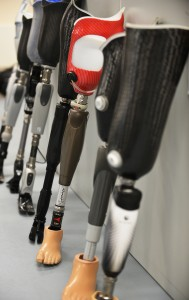 Prosthetic limbs are lined up against a wall at the Defence Medical Rehabilitation Centre, Headley Court. [Cpl Richard Cave RLC (Phot) MOD/CrownCopyright2013]