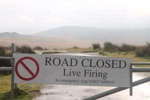 A sign informing the public that the road is closed due to live firing. [Helen Pickering; Crown Copyright/MOD2014]