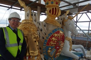 Jon Butler at completed heraldic crest on roof of Royal Artillery Barracks, Woolwich. [Crown Copyright/MOD2014]