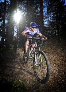 a Royal Air Force mountain biker is pictured in a race at Thetford Forest. (SAC Chris Hill, Crown Copyright)