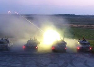 Tanks firing at twilight at Castlemartin Training Area [Crown Copyright]