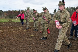 Army cadets and Scouts scattering seeds for wild flowers