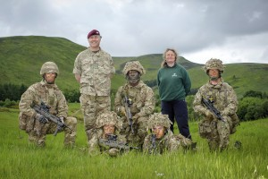 Soldiers from The Royal Highland Fusiliers 2nd Battalion of the Royal Regiment of Scotland train on land that is earmarked for a commemorative living memorial for Scotland's First World War Heroes. They are pictured with Peter Hollins of the Ministry of Defence and Carol Evans from Woodland Trust Scotland. [Helen Pugh]