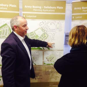 Stephen Harness explaining the plans to a local resident (Crown Copyright/ MOD2015)