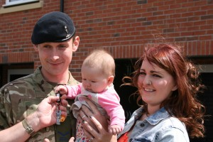 The keys for L/Cpl Neely and his wife's new home are handed to their daughter (Helen Pickering, Crown Copyright/MOD 2015)
