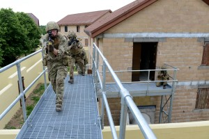 Soldiers from 1 YORKS training on high level walkways at Copehill Down Village. [Landmarc Solutions 2015]