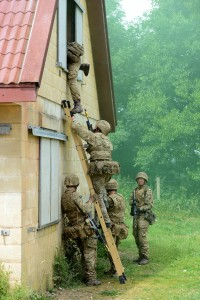 Soldiers from 1 YORKS enter a building in Copehill Down Village as part of a training exercise. [[Landmarc Support Services 2015]