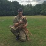 Private Matthew Greig of 1 Military Working Dogs Regiment, with Bracken. [Crown Copyright]