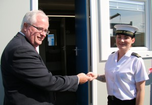 Leo O'Shea, DIO's Director of Service Delivery, hands over the key to her new cabin to AB Leanne Roberts. [MOD/Crown Copyright 2015]