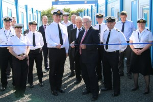 Leo O'Shea, DIO's Director of Service Delivery, and Cdr Mark Hugesdon cut the ribbon at the handover of the first tranche of modular accommodation. [MOD-CrownCopyright2015].