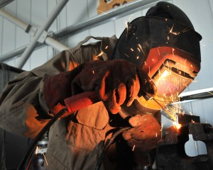 A Lance Corporal in the REME (Royal Electrical Mechanical Engineers) is pictured welding a vehicle component in Afghanistan. [MOD/Crown Copyright2012]