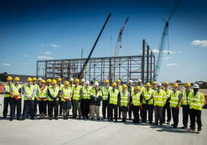 DIO project manager Denis Williams (front centre) with partners celebrating the first stage of A400M hangar's steelwork at RAF Brize Norton [Crown Copyright/MOD2015]