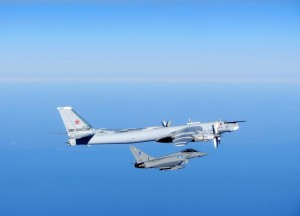 A Typhoon from RAF Lossiemouth intercepting a Russian Bear aircraft as part of a QRA scramble, 16 September 2014. [Crown Copyright/MOD 2014]