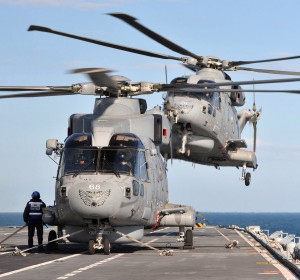 20121104 - Merlin helicopters from 814 Naval Air Squadron are pictured onboard HMS Illustrious during Exercise Joint Warrior near Scotland [Crown Copyright - MOD2012]
