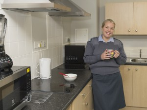 Flt Sgt Kerry Finlay in her new accommodation in the Sgt Mess at RAF Wyton, built under Project SLAM. [Crown Copyright]