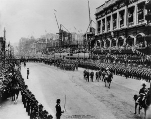 The procession for the coronation of King Edward VII passes the construction of The Old War Office building in Whitehall, London in 1902.