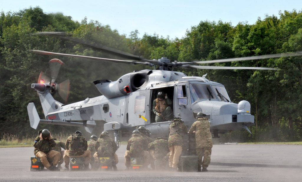 Ground crew reservists are pictured during a training exercise with the new Wildcat helicopter. [Crown Copyright/MOD]
