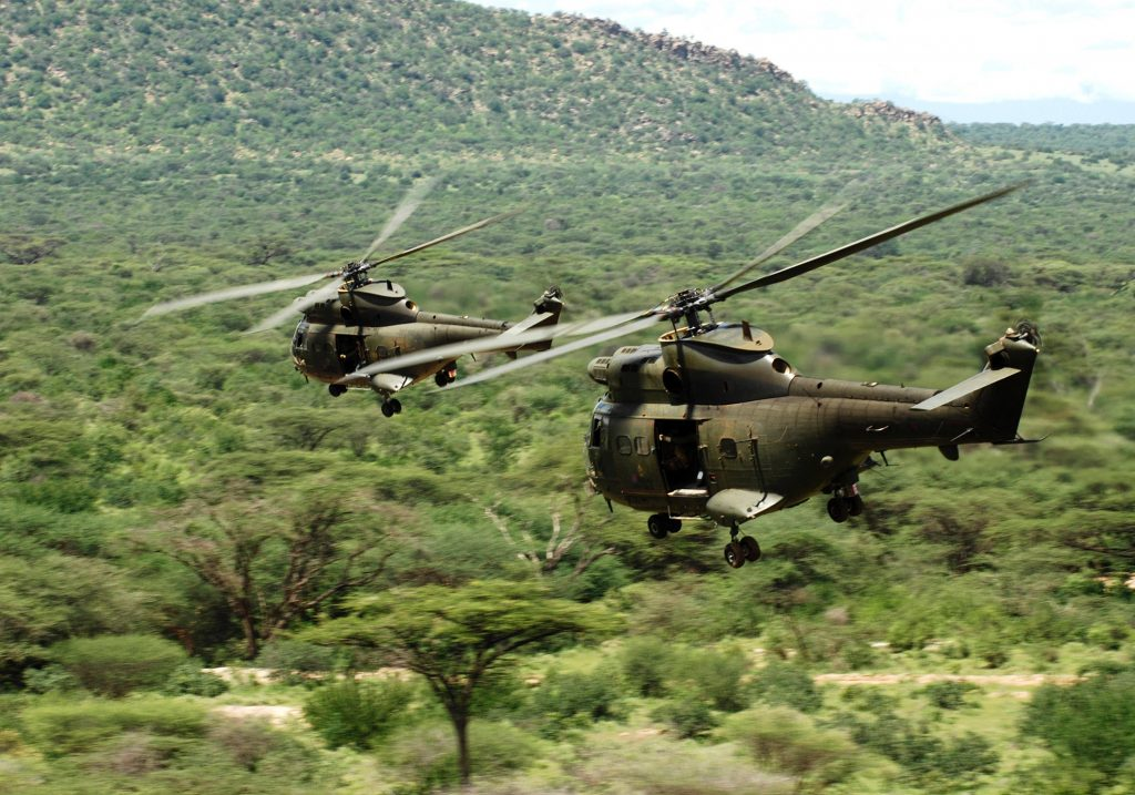 Two RAF Puma HC1 helicopters flying low and fast during Exercise Askari Thunder in Kenya. [Crown Copyright/MOD2011]