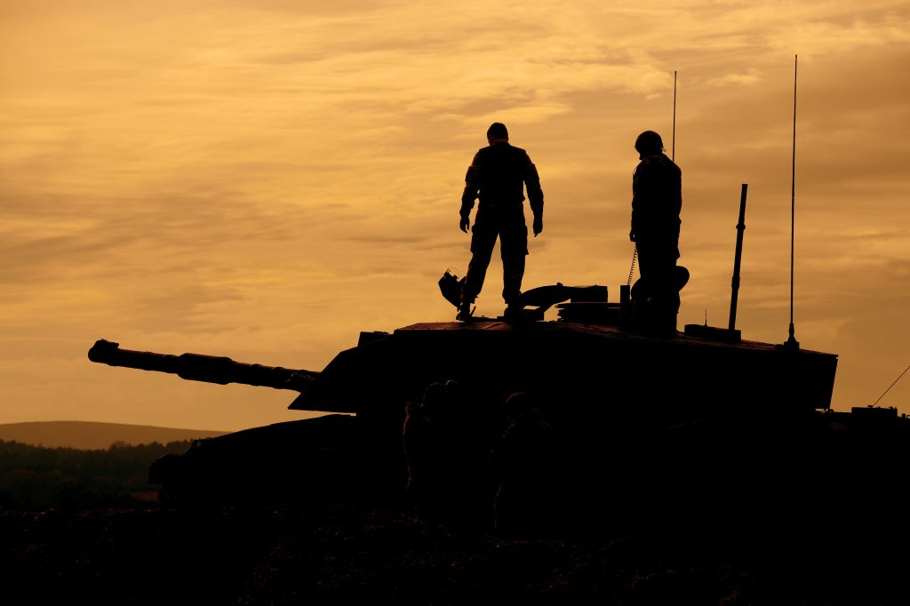 Soldiers with the Royal Wessex Yeomanry onboard a Challenger 2 main battle tank during a training exercise at Lulworth Cove in Dorset. [Crown Copyright/MOD2013]