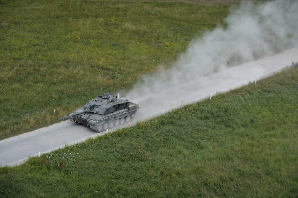 A Challenger 2 Main Battle Tank on a Salisbury Plain access road during Exercise Lion Strike. [Crown Copyright]