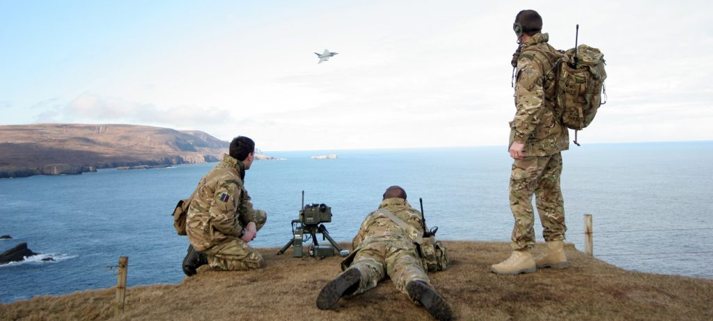 RAF Regiment Forward Air Controllers (FACs) from the Air Land Integration Cell (ALIC), based at RAF Honington (Suffolk), guide a Typhoon from 6 Squadron onto their target at the Cape Wrath practice range in Scotland. [Crown Copyright/MOD2013]