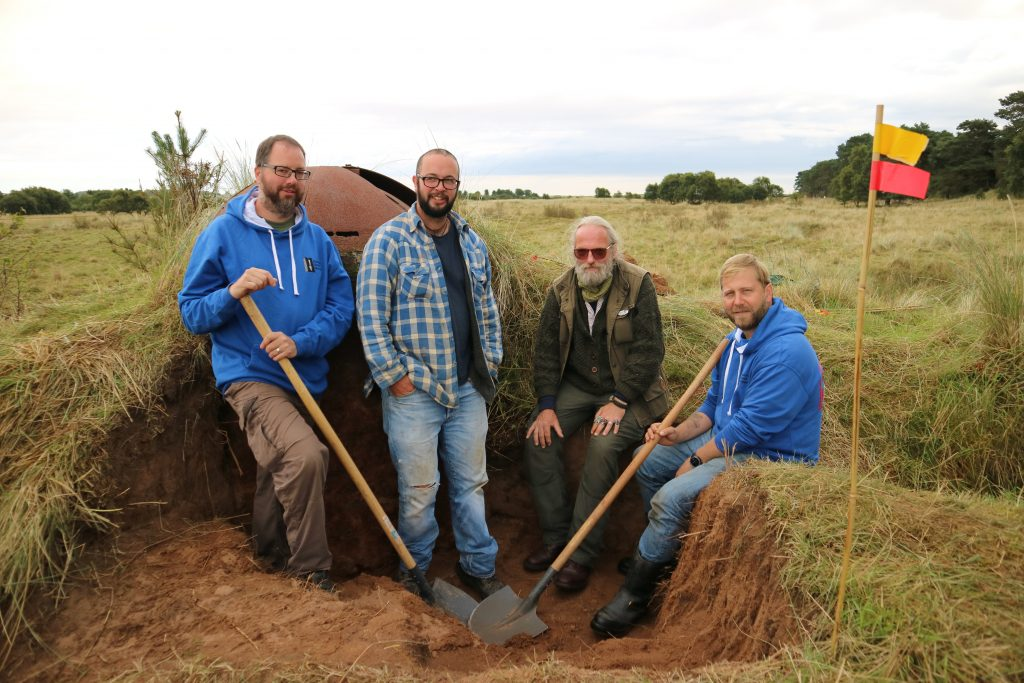 Left to right: Alex Sotheran, DIO archaeologist; Sam Fairhead, Wessex Archaeology; Stewart Bowman, veteran participant; Dickie Bennett, Breaking Ground Heritage. [Crown Copyright / MOD 2017]
