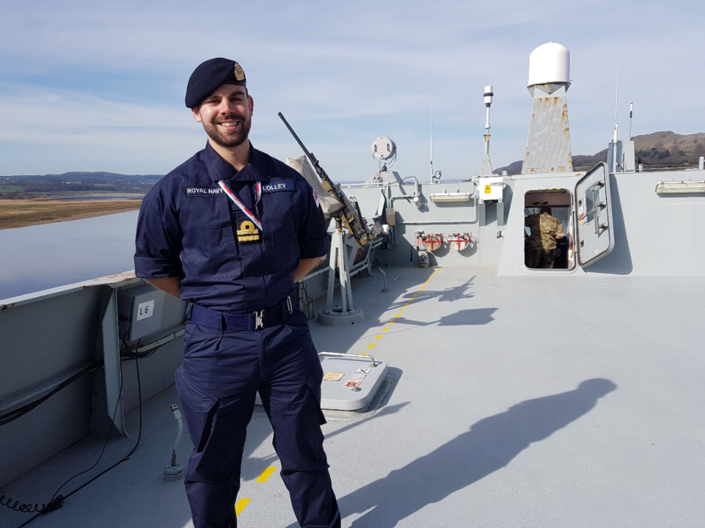 Reservist Ben Lolley on the upper deck of the Danish warship HDMS Absalon. [Crown Copyright, MOD 2017]