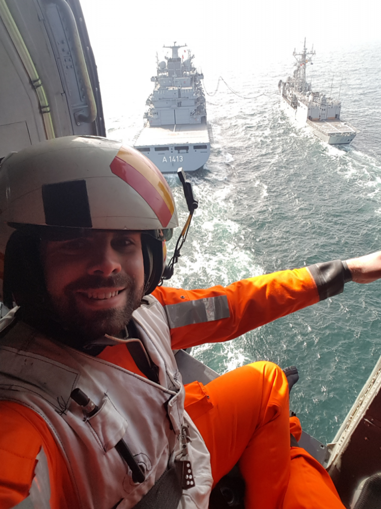 Reservist Ben Lolley in a Spanish Navy 'SeaHawk' helicopter flying over two ships being replenished at sea. [Crown Copyright, MOD 2017]