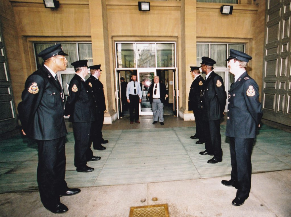 MGS staff outside Main Building in their old uniforms. [Crown Copyright/MOD]