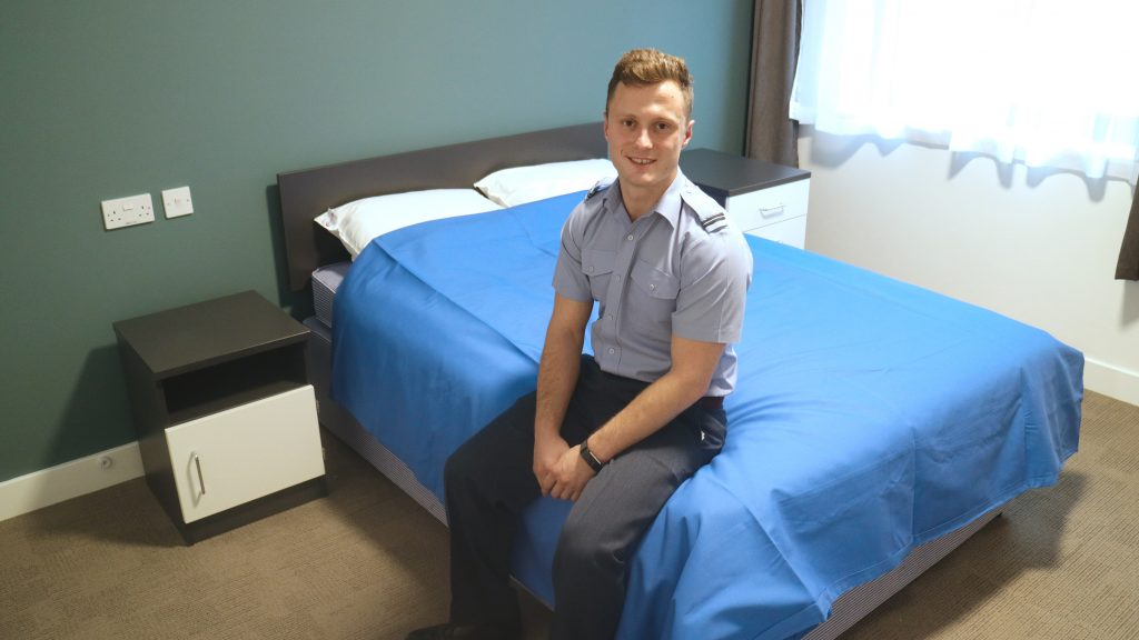Flying Officer Niall Dowse in his new room for the first time. [Crown Copyright/MOD2017]