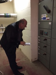 Watching the clocks - Stephen Mead, ITC checking meter readings.