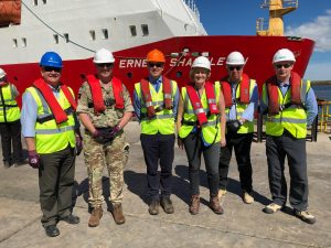 DIO's David Graham, Brigadier Baz Bennett and DIO's Geoff Robson, DIO's Lucy Bogue, John Lovell from VolkerStevin and Paul Stubbs from RambollUK open the jetty in Mare Harbour (Crown Copyright, MOD 2018)