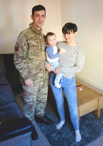 Family enjoying their new service accommodation in Ashdown, Wiltshire [Crown Copyright, MOD 2018]