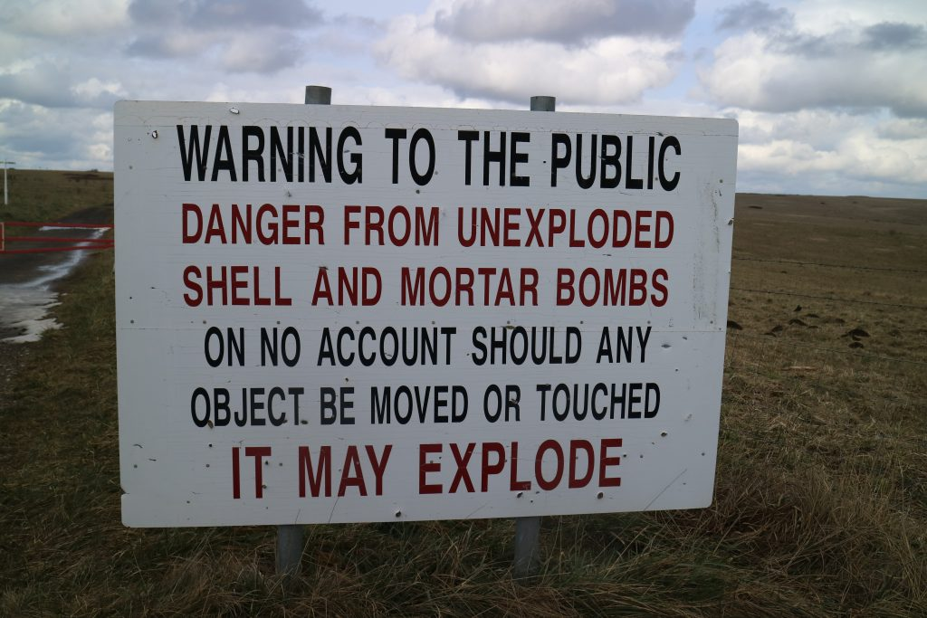 The unexploded ordnance warning signs are very clear. [Crown Copyright, MOD2018]