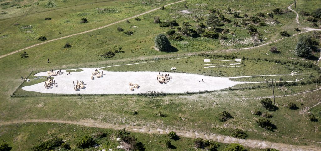 Aerial image of volunteers spreading chalk on Bulford Kiwi [Crown copyright, MOD 2018]