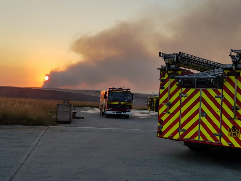 Firefighters from Dorset & Wiltshire Fire and Rescue Service monitoring the fire on Salisbury Plain Training Area. [Photograph courtesy of Dorset & Wiltshire Fire and Rescue Service]