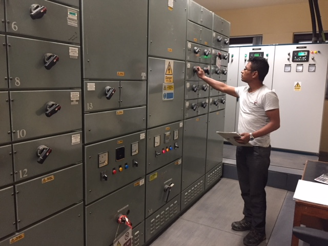 One of our Nepali team working in the Standby Generator Room. [Crown Copyright]