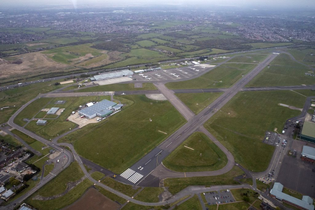 A view of RAF Northolt from the air, showing the main runway and a number of buildings.