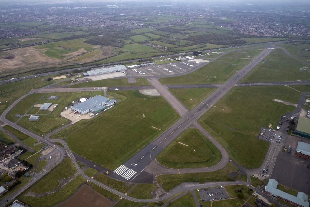 RAF Northolt from the air, with the main runway and various buildings visible.